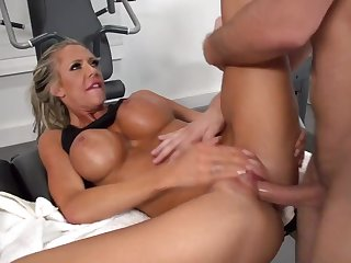 Milf with huge tits shagged hard by her gym trainer