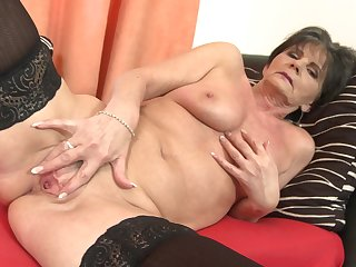 Short haired mature amateur granny Rayna S. strips and masturbates