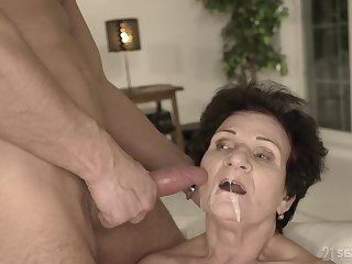Mature short haired redhead granny Lisbeth gets a cumshot on her face