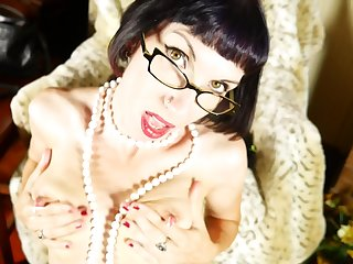 Nerdy mature brunette amateur Alyce strips and pounds her pussy