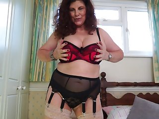 Curly haired redhead mature amateur Gilly flaunts her huge ass