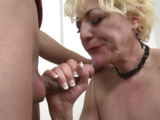Mature busty amateur blonde granny Alisah takes cum in her mouth