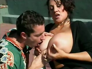 Juicy big breasted cougar is sucking a nice stiff cock on the tennis court