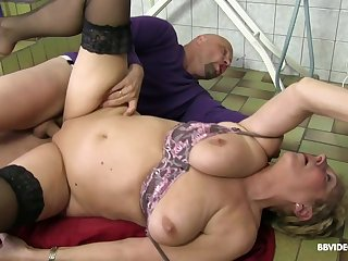 Short haired granny with glasses pounded by two guys and toys