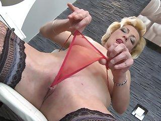 Amateur mature blonde granny Alisah strips in the bathroom