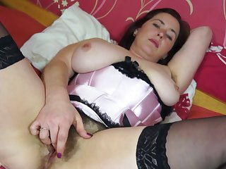 Janey has huge tits and she masturbates while playing with them