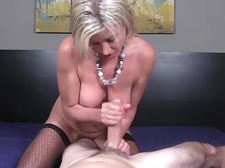 Mature beauty tugging dick in stockings
