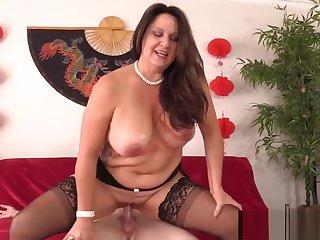 Curvy Older Brunette Woman Leylani Wood Mounts a Hard Cock