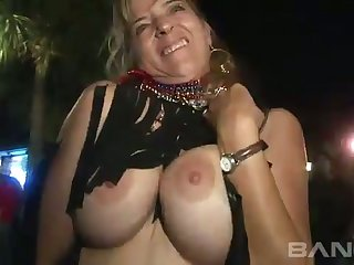 These sluts aren't new to public nudity and they like to show off their boobs