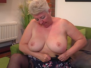 Short haired mature amateur blonde granny Babet spreads her ass
