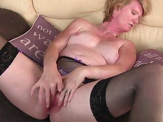 Short haired blonde mature MILF Sarah H. plays with a vibrator