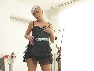 Mature amateur short haired blonde Kathy White strips and masturbates
